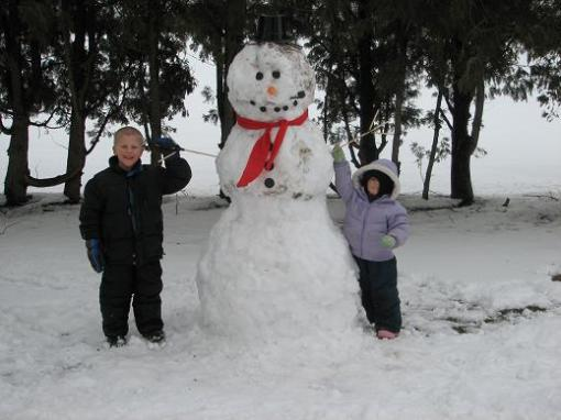 William and Niamh Standing with the Snowman