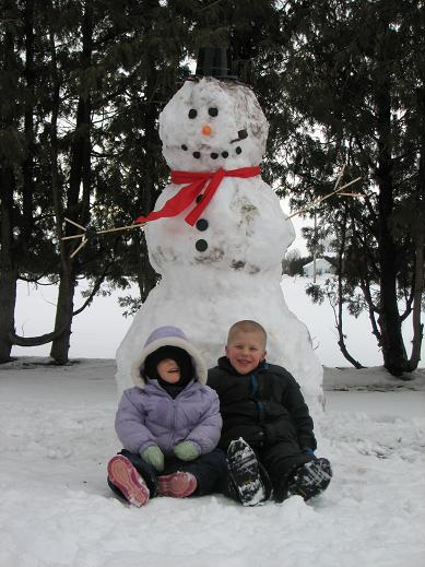 William and Niamh Sitting with the Snowman